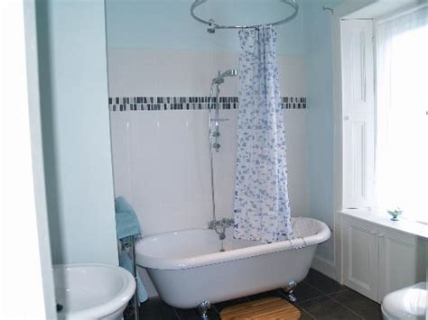 roll top bath and shower en suite with roll top bath and overhead shower picture