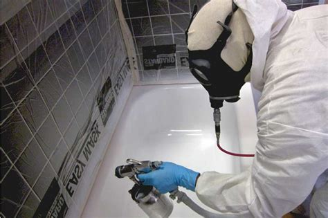 how do you refinish a bathtub bathtub refinishing professional refinisher spraying a tub