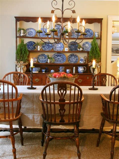 Country Dining Room Lighting A Wrought Iron Chandelier With Candle Like Lights Accents This Style Dining Room