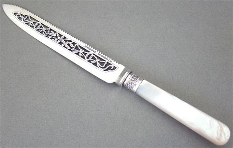 Wedding Cake Knife by Exquisite Silver And Silver Plated Wedding Cake Knife By