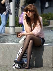 candid uk with legs crossed and wearing she performs