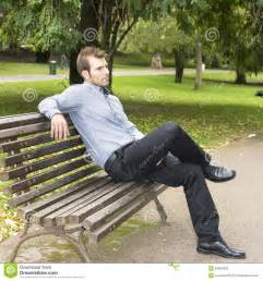 sitting on a bench sitting on a bench in the park stock photos image