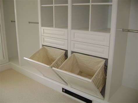 bathroom cabinet with built in laundry her custom closets wood traditional closet new york by