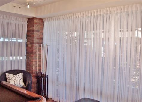 pleated window curtains high rise condo with wal to wall pinch pleated sheers