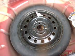 2005 ford taurus tire size is there for putting your and spare tire back