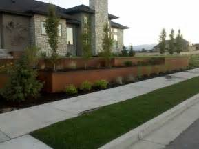 Retaining Wall Front Yard - natural rust finish steel planter and retaining