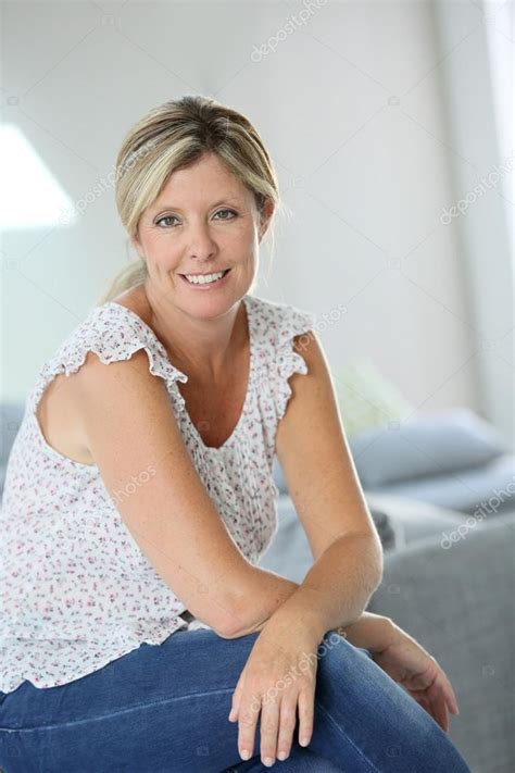 where do 40 year old woman shop beautiful 40 year old woman at home stock photo