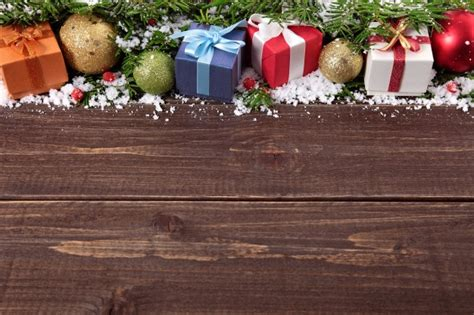 christmas gifts on wooden background photo free download