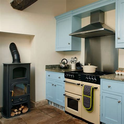 country kitchen with range cooker housetohome co uk blue and cream kitchen with range cooker kitchen