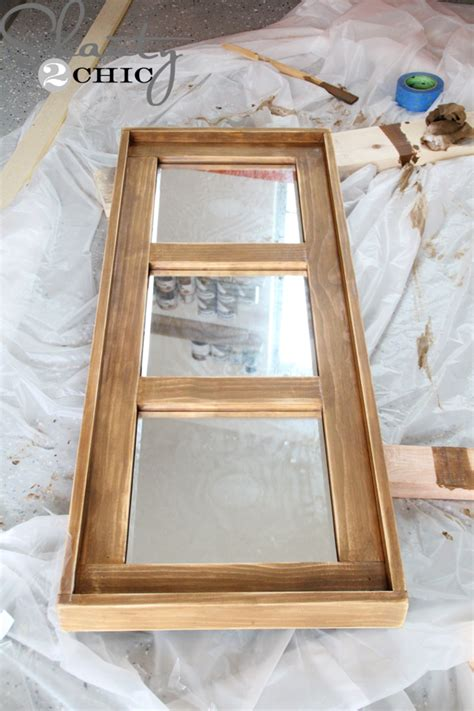 attaching the frame to your mirror diy wooden mirror shanty 2 chic