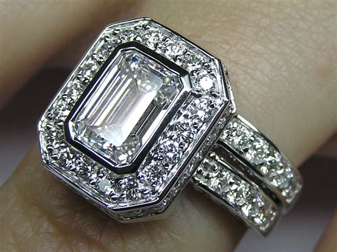 emerald cut bezel set halo bridal set