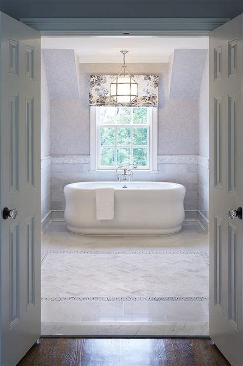 tub nook  marble wainscoting traditional bathroom