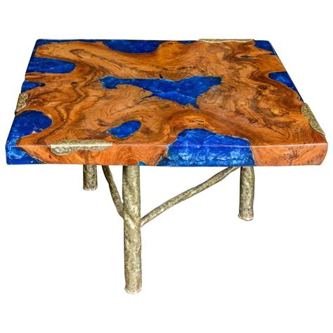 cocktail table with blue resin and wood by henri fernandez