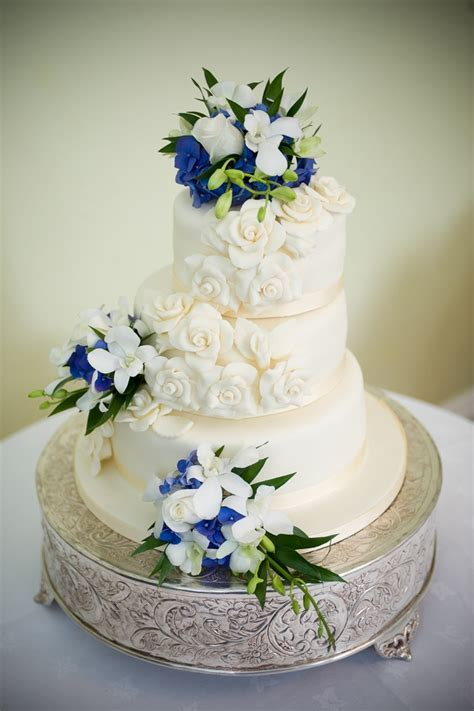 Classic wedding cake with blue flowers. http