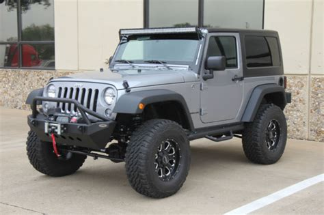 silver jeep lifted 2015 silver jeep wrangler lifted on 35s 7 miles