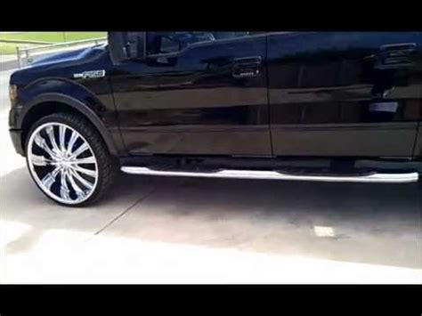 ford f150 on 28s with 3 12 inch subs custom box and suede