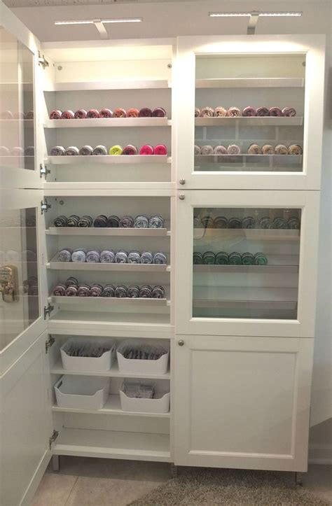 ikea besta cabinets glass doors and lighting make this besta cabinet a great place to showcase the creations you re