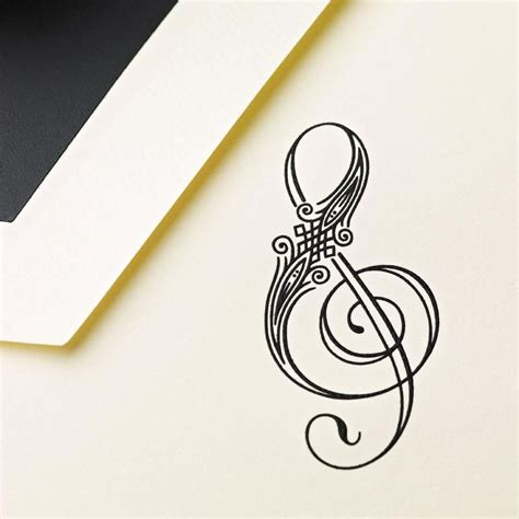 small treble clef tattoos great inspiration for a musical engraved