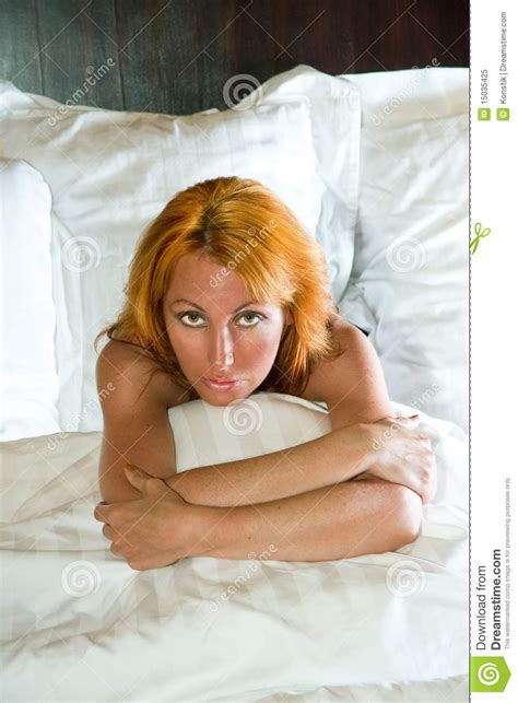 young pretty woman in bed royalty free stock photo image