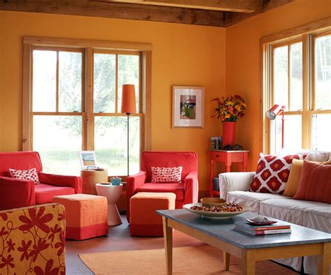 add color to your living room orange living rooms warm colors and armchairs