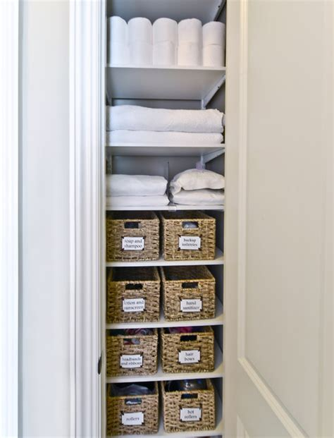 organizing bathroom closet linen closet storage organized living freedomrail transitional closet