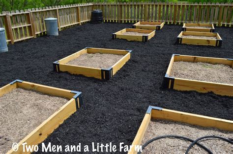 mulch beds two men and a little farm raised bed mulch is done