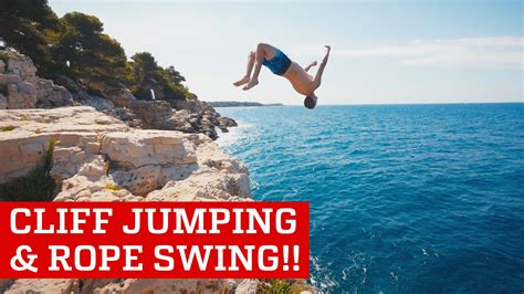 russian rope swing extreme cliff jumping giant rope swing daredevils