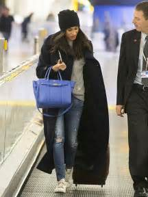 prince harry s girlfriend meghan markle is glued to her phone in toronto after a