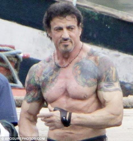 sly stallone shows off ripped physique and performs his