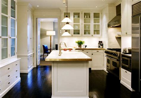 white kitchen cabinets with wood floors cottage