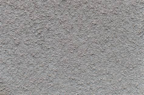 grey wall texture concrete tiny rocks in light gray concrete wall