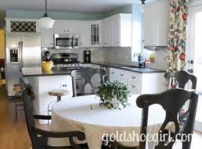 beautiful white kitchen cabinets black granite blue walls