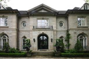 White Painted Brick Exterior - stone mansion french home exterior pricey pads
