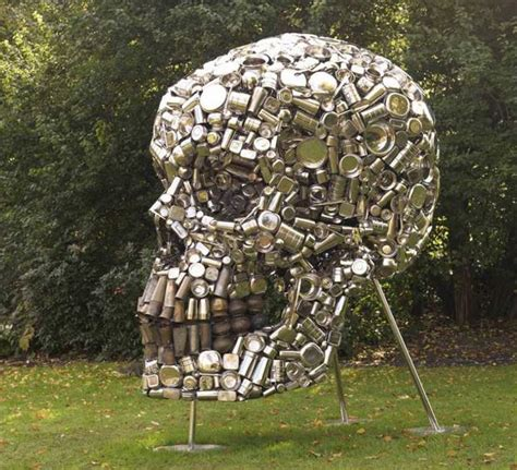 can sculpture giant skull made of pots and pans recyclenation