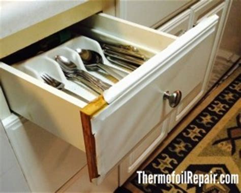 foil kitchen cabinet doors kongfans com how to repair thermal foil cabinets mf cabinets