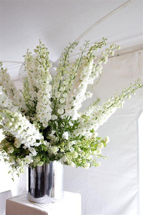 all white www.belathee.com   tall flower arrangements