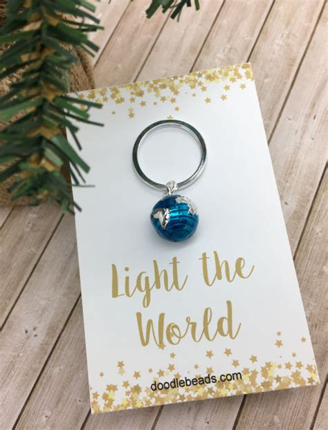 light the world lds christmas gifts world key chain globe