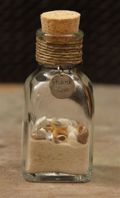 Beach Giveaways - beach wedding favors have the guests fill the bottle with sand from the beach after