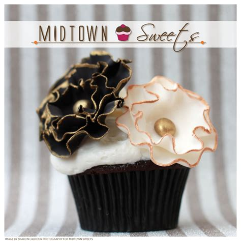 midtown sweets black white flower cupcakes  gold trim