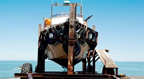 man of steel fishing boat captain ngawi beach launched fishing fleet new zealand bulldozers