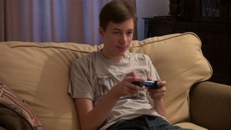couch player teenage boy playing video games player game controller