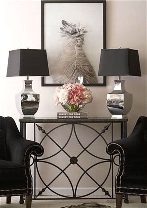 table between two armchairs a lovely detailed console table is placed between two