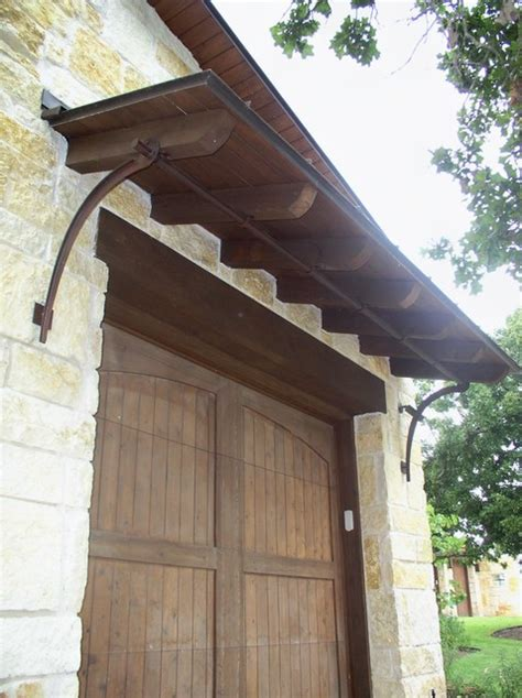 Garage Door Awnings by Garage Door Shed Roof And Iron Bracket Support