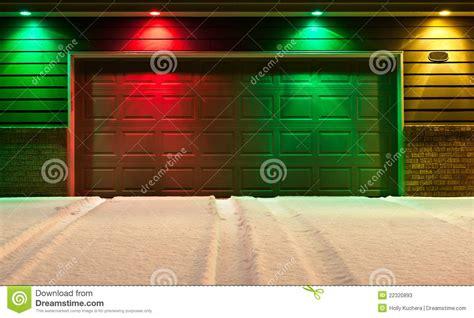 Garage Door Yellow Light Multi Colored Garage Door And Snowy Driveway Stock Image