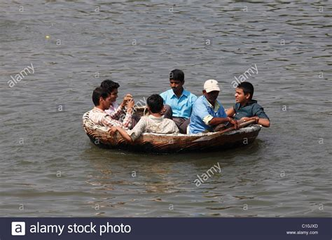 round boat young men on traditional round fishing boat on kapila