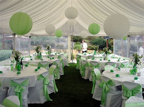 Decorated dinner tables, sage green wedding green and