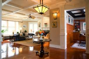 warm home interiors warm lighting in a craftsman style entryway and family room
