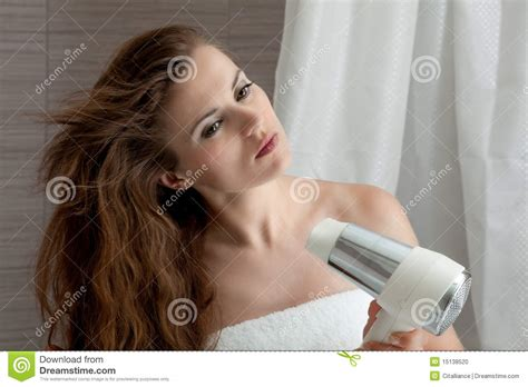 women using the bathroom women using the bathroom attractive woman using fen in bathroom stock photo image