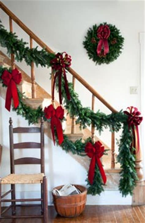 garland on banister emilie s christmas bows