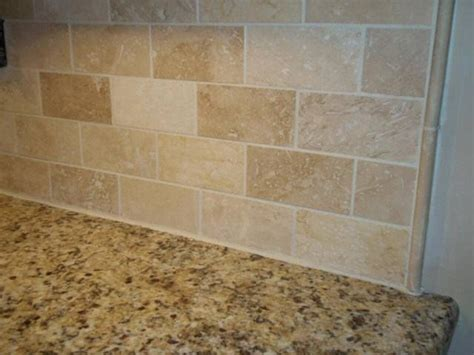 Travertine Tile Kitchen Backsplash Venetian Gold Granite With A Simple Travertine Subway Tile Backsplash With Pencil Strips Accents